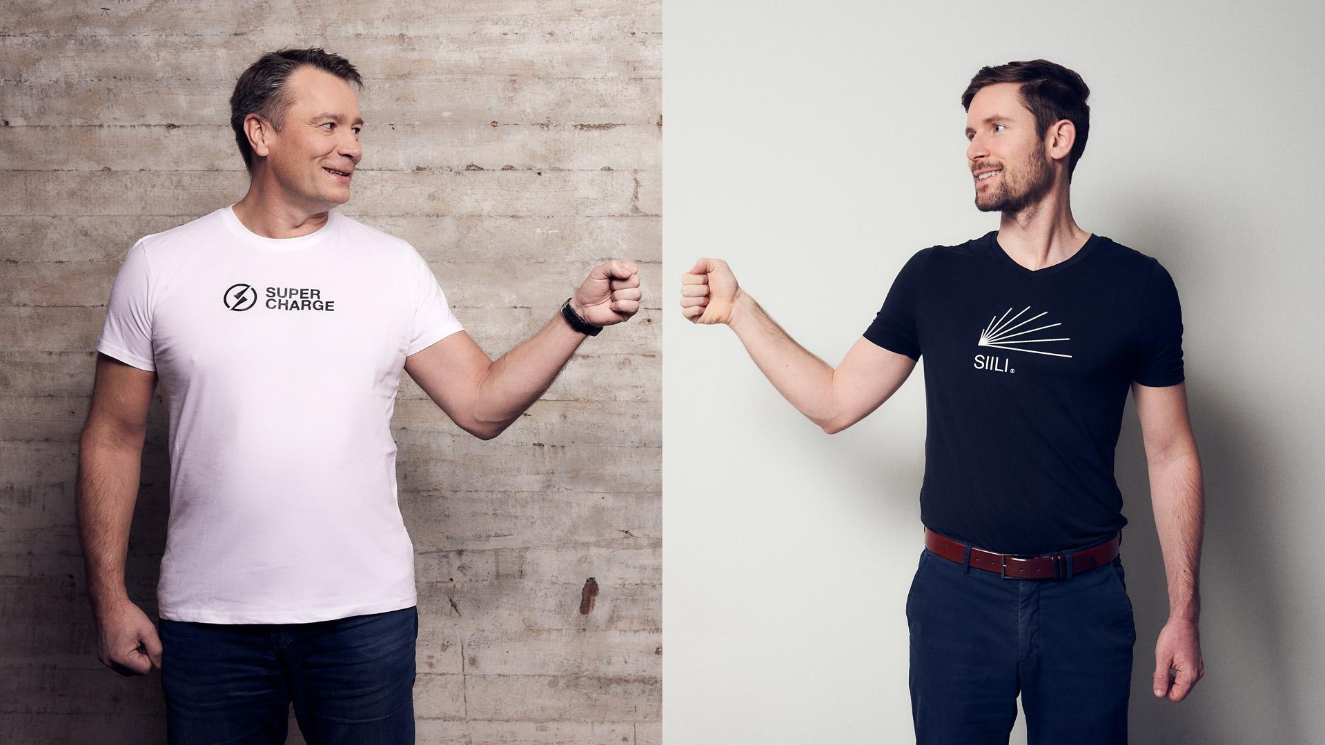 Siili's CEO Marko Somerma and Supercharge's CEO Andras Tessenyi fistbump 1937 kilometers apart
